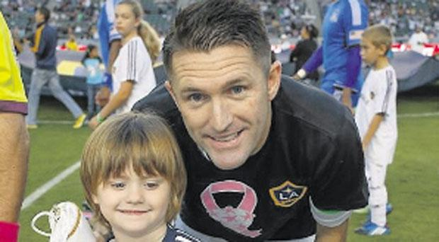 Match: Ireland star Robbie Keane and son Robert junior