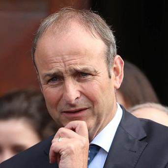 Micheal Martin, pictured, has led the tributes after former Fianna Fail minister Noel Davern died