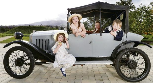 Jump start: trying out a Peugeot Quadrilette from 1923 are Noala O'Morain (4), Abbie Flynn (6), James Archbold (8), and Ronan O'Moran (4)