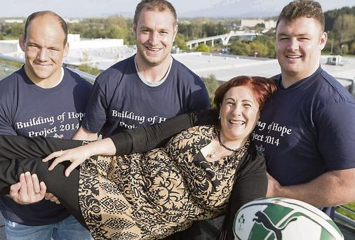 Munster rugby players, BJ Botha, Johne Murphy and David Kilcoyne at the Building of Hope event, with project director Maureen McCarthy