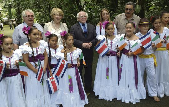 President Michael D Higgins and his wife Sabina are greeted by local children on the final leg of his state visit to Latin America