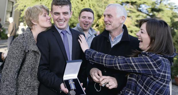 Padraic Manning, who got his bravery award for rescuing a child from the water off Dingle Pier, with his family