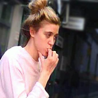 A woman who turned up distressed on a city centre street has now been identified