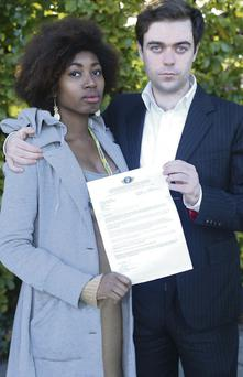 Jazmine Byas and her partner, Danny Lambert, with the letter turning down their 'de facto relationship' application