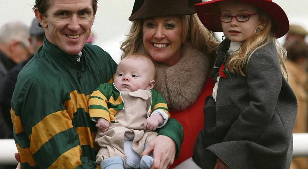 Tony McCoy with his daughter Eve, young son Archie and his wife Chanelle after notching his 4,000th win at Towcester.