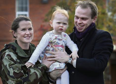 Comdt Caroline Burke with her husband Kieran Costello and their 22-month-old daughter Vanessa