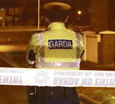 A garda at the scene of the shooting in Coolock