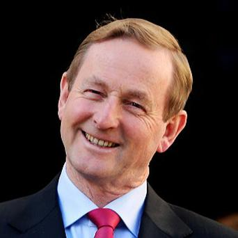 Enda Kenny: has taken pay cut