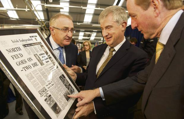Enda Kenny with Leo Crawford of BWG at the the Value Centre Castlebar, Co Mayo, where they presented him with a copy of an Irish Independent front page from the day of his by-election victory in 1975