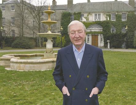 Former Taoiseach Charles Haughey outside his Abbeville mansion, which was designed by James Gandon.