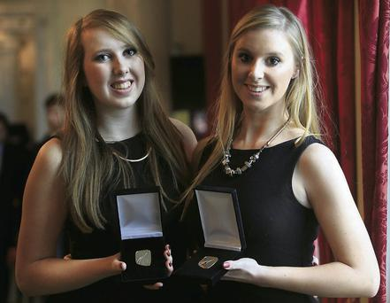Sisters Ailbhe (19) and Treasa Kelly (21), from Falcarragh, Co Donegal, with their medals