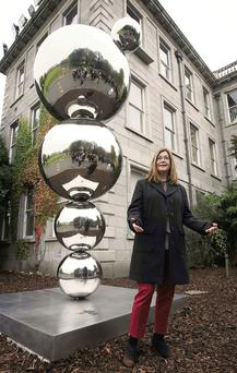 Artist Eilis O'Connell at TCD with her sculpture celebrating the life and work of Nobel Laureate for Physics Ernest Walton.