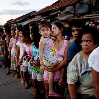People in a line for food aid in Tacloban on the Island of Leyte, Philippines, after Typhoon Haiyan