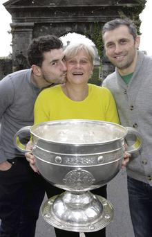 Bernard Brogan (left), with his mother Maria, holding the Sam Maguire, and brother Alan at the opening of the Celbridge Manor Hotel in Co Kildare.