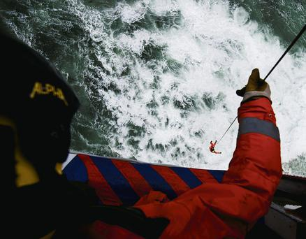 Volunteer Neville Murphy is winched down from a helicopter at Dunmore East