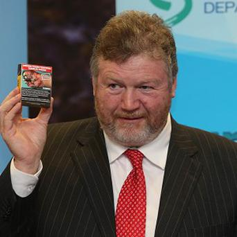 Health Minister James Reilly holds a press conference as he announces Government approval for larger health warnings on tobacco packs