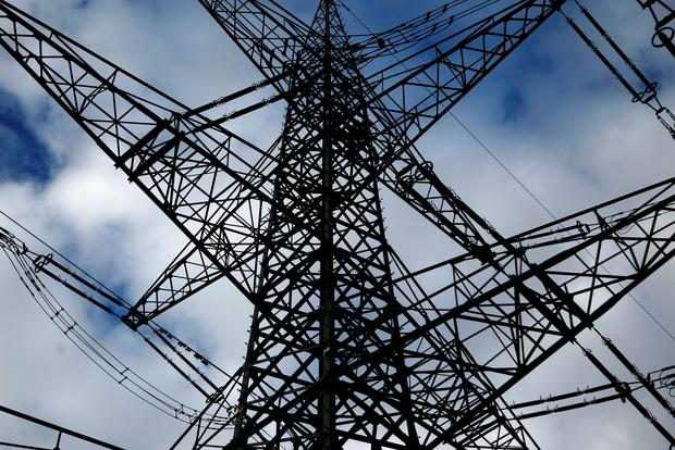 An electricity pylon in the western city of Meckenheim in this January 30, 2013 file photo. E.ON, Germany's No.1 utility, lowered the upper end of its full-year profit target range after plunging power prices and a boom in renewable energy caused nine-month profit to decline by a fifth. The group said on November 13, 2013 it now saw earnings before interest, tax, depreciation and amortisation (EBITDA) reaching 9.2-9.3 billion euros ($12.4-12.5 billion) compared with a previous outlook range of 9.2-9.8 billion. REUTERS/Ina Fassbender/Files (GERMANY - Tags: ENERGY BUSINESS)