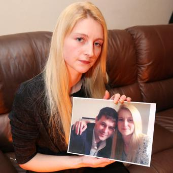 Rachael Gaffney pictured with a photo of her and her deceased brother Christopher Gaffney at her home yesterday.
