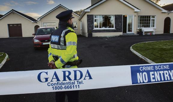 A garda at the scene of the robbery in Killenaule, Co Tipperary