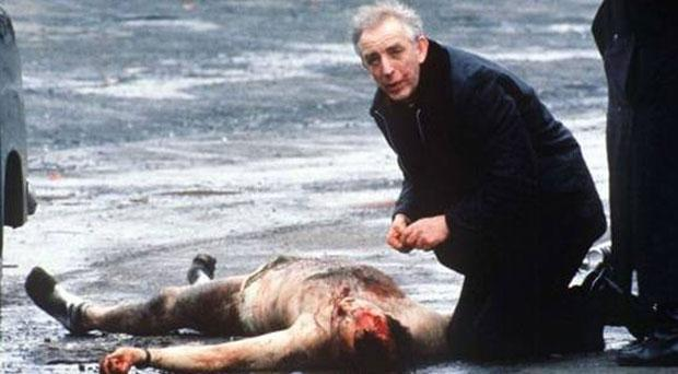Fr Alec Reid pictured after his attempts to resuscitate two soldiers before giving them the last rites, on realising they were dead