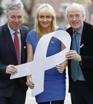 Miriam O'Callaghan with FAI chief John Delaney and Men Development's Network CEO Alan O'Neill at the launch of the White Ribbon campaign.