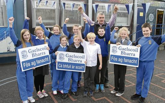 Sixth-class pupils from Gaelscoil Bharra, Cabra, and principal Sean O Donghaile celebrate the welcome news. Declan Masterson