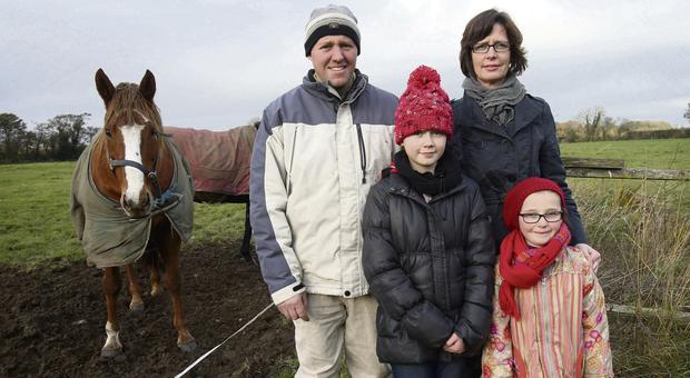 COUNTRY LIFE: Liam and Simone Webb with their children Sophie, 10, and Isobel, 6, at part of the proposed pylon route in Kellistown, Co Carlow