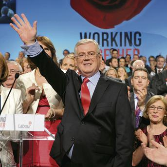 Tanaiste and Labour leader Eamon Gilmore waves to delegates after addressing his party's annual conference in Killarney last Saturday night