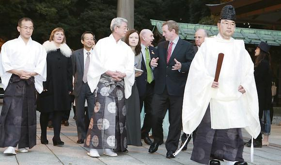 Taoiseach is welcomed by Shigehiro Miyazaki, vice chief of priests, at the Meiji Shrine