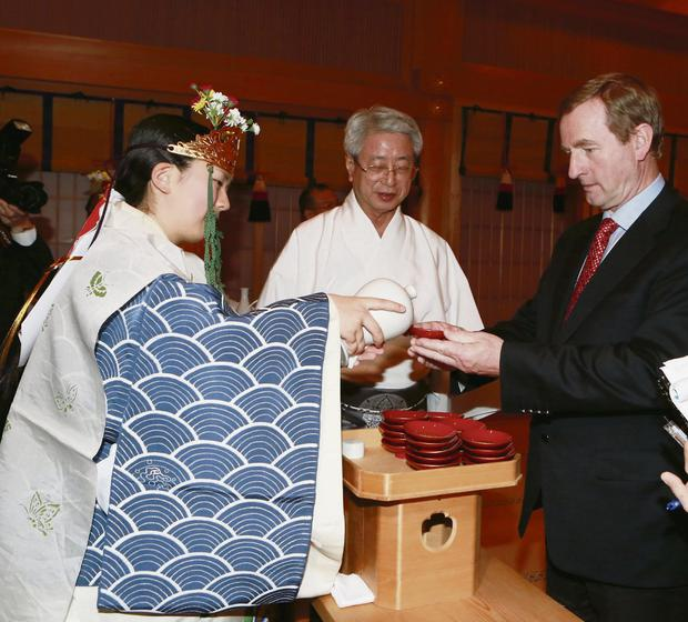 Taoiseach is offered a ceremonial drink of sake (Japanese rice wine)