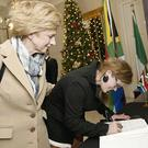Susan Delaney and her daughter Laura signing the book of condolence for Nelson Mandela at the Mansion House in Dublin.