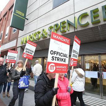 Staff at Marks and Spencer Henry Street in Dublin man picket lines as workers stage a strike over a pension dispute and other cost cutting proposals