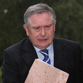 Public Expenditure Minister Brendan Howlin has urged Brian Conlon to address the committee