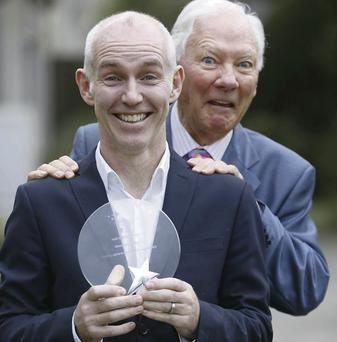 Ray D'Arcy receives an award from Road Safety Authority chief Gay Byrne at the RSA Leading Lights 2013 ceremony in Farmleigh, Dublin