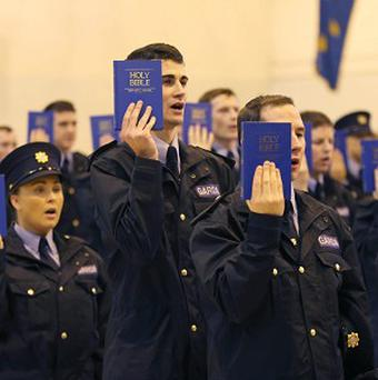 Successful recruits at the Garda Reserve graduation ceremony in Templemore. (PA)