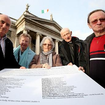 Family members Richard Veale, Marie Horan, Cecilia Daly, Michael Scott and Francis Caffrey attend the launch of the new campaign on O'Connell Street in Dublin