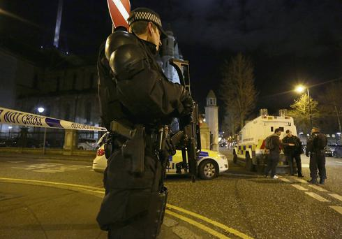 Armed police seal off the Cathedral Quarter after a small explosion in Belfast city centre.