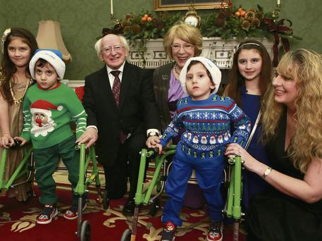 President Michael D Higgins and wife Sabina with Angie Benhaffaf and her children Imen (6), Malika (9) and twins Hussein and Hassan at the Christmas party at Aras An Uachtarain. Picture:Arthur Carron