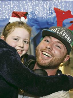 Brian O'Toole (27) is welcomed home from Perth, Australia by his daughter, Kaci (7)