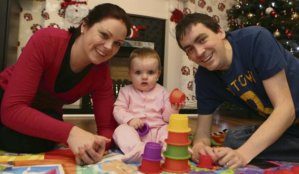 Lung transplant recipient Paul Wynne with wife Ciara and 10-month-old daughter Ella at their home in Laytown. Photo by Arthur Carron