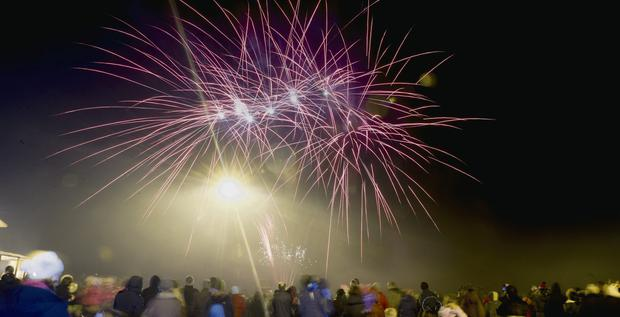 Revellers at a fireworks extravaganza in Tralee