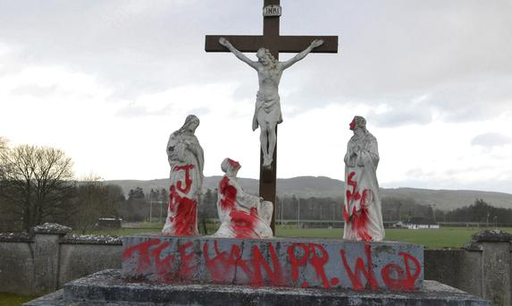 Graffitt daubed by vandals at a Co Kilkenny church during Christmas week