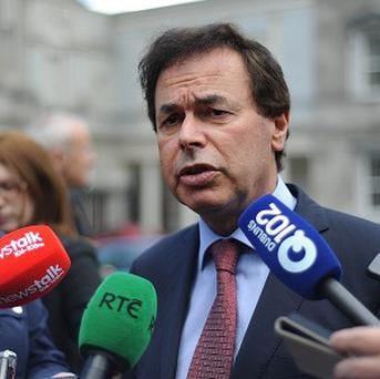 Justice Minister Alan Shatter says the exchange of data with the UK prevents immigration abuses