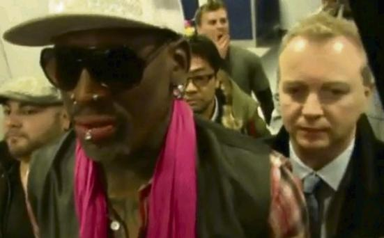 US basketballer Denis Rodman, with Today FM's Matt Cooper in the background, at Beijing Airport en route to Pyongyang.