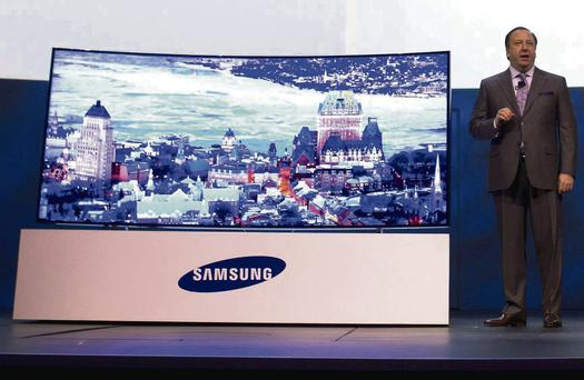 Joe Stinziano, executive vice president of Samsung Electronics of America, introduces a 105-inch, curved UHD television during the Consumer Electronics Show (CES), in Las Vegas, Nevada. Photo: STEVE MARCUS