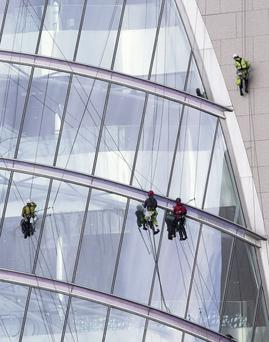 The glass being cleaned on the Convention Centre in Dublin. Mark Condren