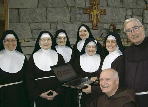 The Poor Clare Sisters, from Galway, and Irish Franciscan friars at the launch of holyname.ie