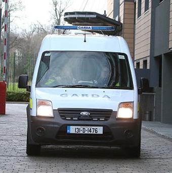A Garda van containing Saverio Bellante is brought before Blanchardstown District Court, Dublin, where he was accused of killing Tom O'Gorman.