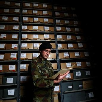 Files in the reading room at Cathal Brugha Barracks, Dublin, are studied by the officer in charge of military archives, Commandant Padraic Kennedy