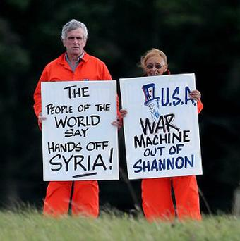 Peace activists Niall Farrell and Margaretta D'Arcy attempting to block the runway of Shannon Airport in protest at its use by US military
